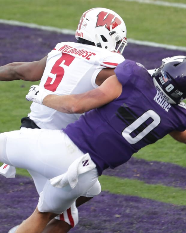 Wisconsin cornerback Rachad Wildgoose is called for pass interference in the end zone while covering Northwestern tight end John Raine in the first quarter Saturday. Mjs Uwgrid22 2 Jpg Uwgrid22