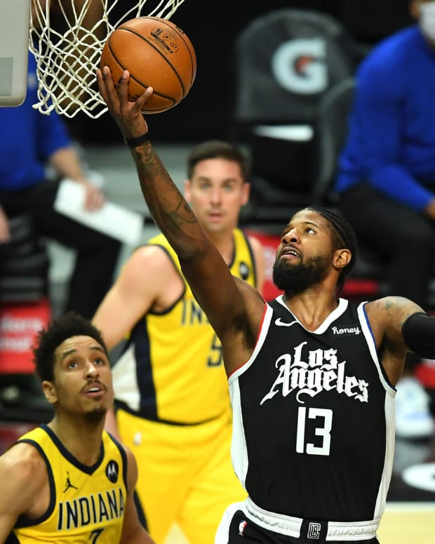 Jan 17, 2021; Los Angeles, California, USA; Los Angeles Clippers guard Paul George (13) goes up for a basket in the first half of the game against the Indiana Pacers at Staples Center. Mandatory Credit: Jayne Kamin-Oncea-USA TODAY Sports