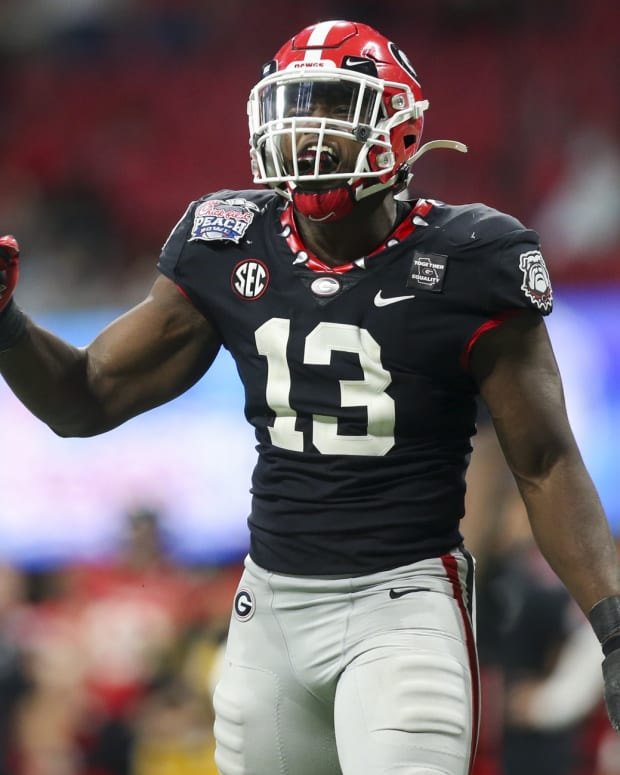 Georgia Bulldogs linebacker Azeez Ojulari (13) celebrates after a sack against the Cincinnati Bearcats in the second half of the Chick-fil-A Peach Bowl at Mercedes-Benz Stadium.