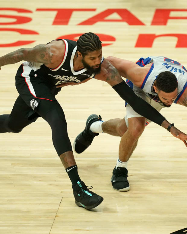 Apr 11, 2021; Los Angeles, California, USA; LA Clippers guard Paul George (13) and Detroit Pistons guard Cory Joseph (18) reach for the ball in he second half at Staples Center. Mandatory Credit: Kirby Lee-USA TODAY Sports