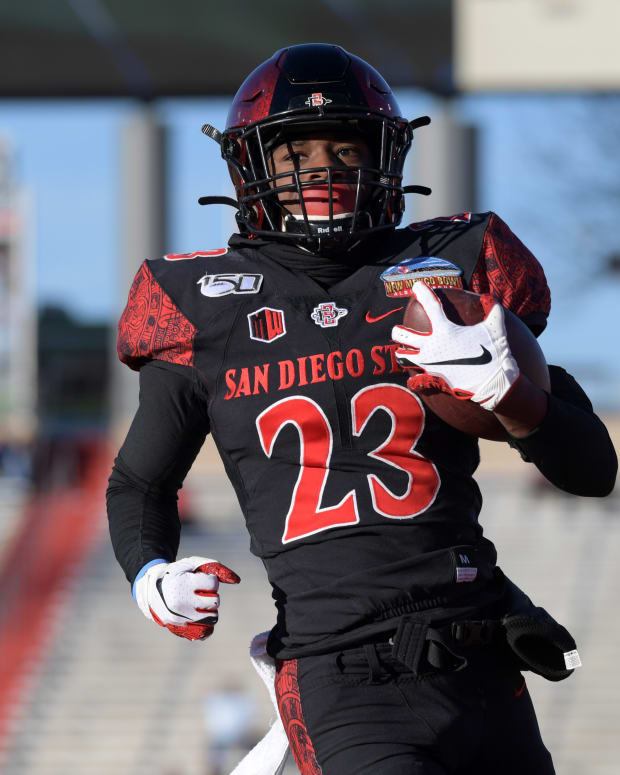 Dec 21, 2019; Albuquerque, New Mexico, USA; San Diego State Aztecs cornerback Darren Hall (23) scores on a 20-yard fumble recovery in the fourth quarter against the Central Michigan Chippewas during the New Mexico Bowl at Dreamstyle Stadium. San Diego State defeated Central Michigan 48-11. Mandatory Credit: Kirby Lee-USA TODAY Sports