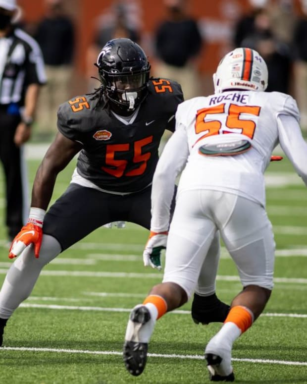National offensive lineman James Hudson III of Cincinnati (55) faces off against American defensive lineman Quincy Roche of Miami (55) in the first half of the 2021 Senior Bowl at Hancock Whitney Stadium.