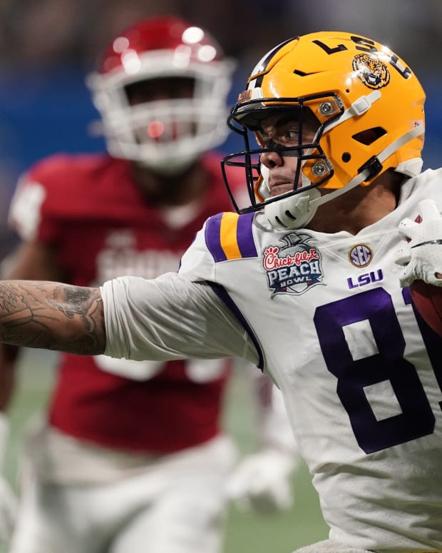 Dec 28, 2019; Atlanta, Georgia, USA; LSU Tigers tight end Thaddeus Moss (81) runs after a pass reception against the Oklahoma Sooners during the second quarter of the 2019 Peach Bowl college football playoff semifinal game. Mandatory Credit: John David Mercer-USA TODAY Sports