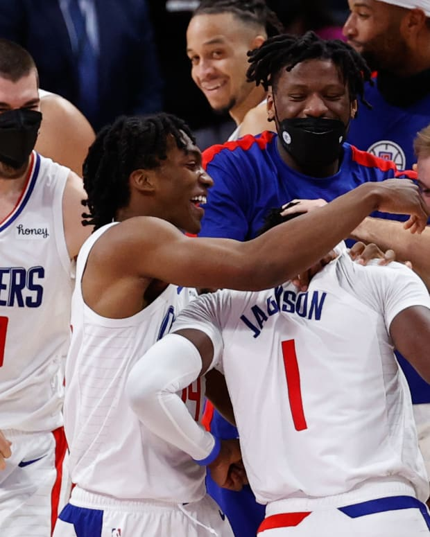 Apr 14, 2021; Detroit, Michigan, USA; LA Clippers guard Reggie Jackson (1) is congratulated by teammates after the game against the Detroit Pistons at Little Caesars Arena. Mandatory Credit: Rick Osentoski-USA TODAY Sports