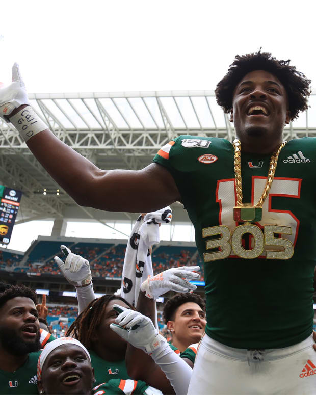 Sep 21, 2019; Miami Gardens, FL, USA; Miami Hurricanes defensive lineman Gregory Rousseau (15) celebrates wearing the turnover chain during the first quarter of a football game against the Central Michigan Chippewas at Hard Rock Stadium. Mandatory Credit: Sam Navarro-USA TODAY Sports