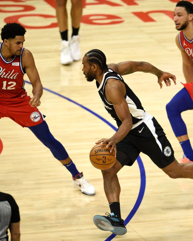 Mar 27, 2021; Los Angeles, California, USA; LA Clippers forward Kawhi Leonard (2) drives to the basket while Philadelphia 76ers forward Tobias Harris (12) defends during the first half at Staples Center. Mandatory Credit: Kelvin Kuo-USA TODAY Sports