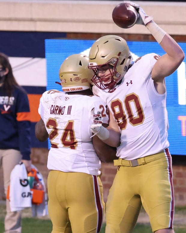 Dec 5, 2020; Charlottesville, Virginia, USA; Boston College Eagles tight end Hunter Long (80) celebrates with Eagles running back Pat Garwo III (24) after catching a touchdown pass against the Virginia Cavaliers in the second quarter at Scott Stadium.