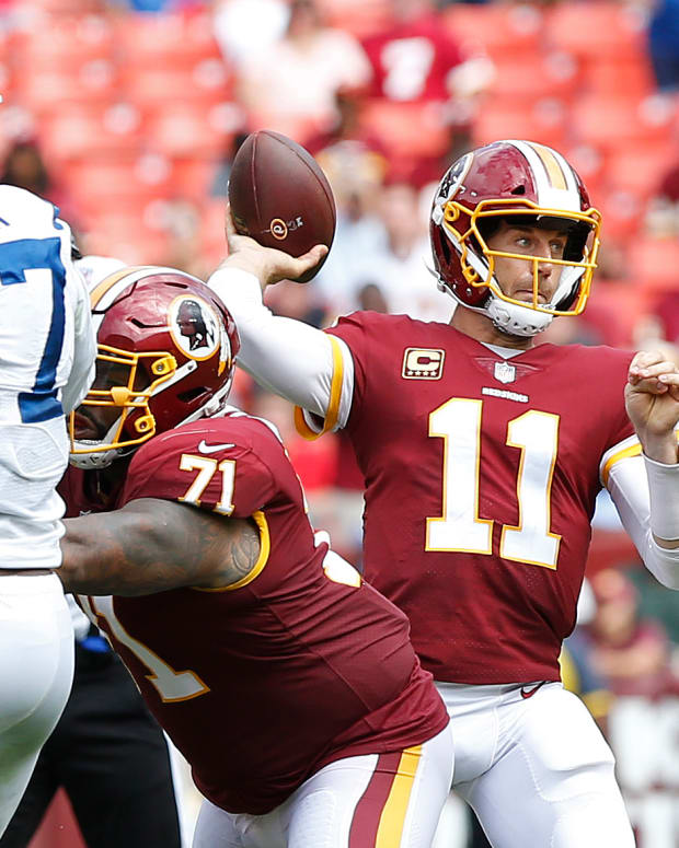 Sep 16, 2018; Landover, MD, USA; Washington Redskins quarterback Alex Smith (11) passes the ball as Indianapolis Colts defensive end Kemoko Turay (57) defends in the third quarter at FedEx Field. The Colts won 21-9. Mandatory Credit: Geoff Burke-USA TODAY Sports