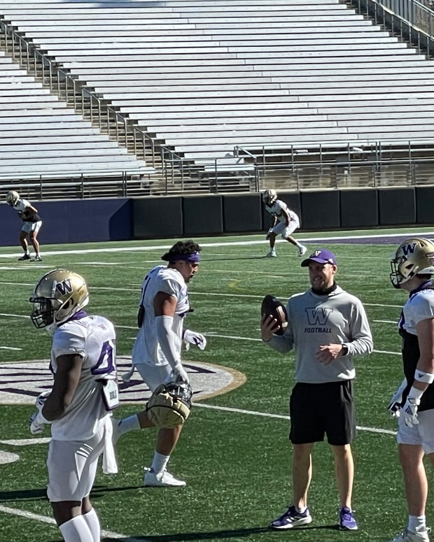 The Huskies limber up as Saturday's practice gets under way.