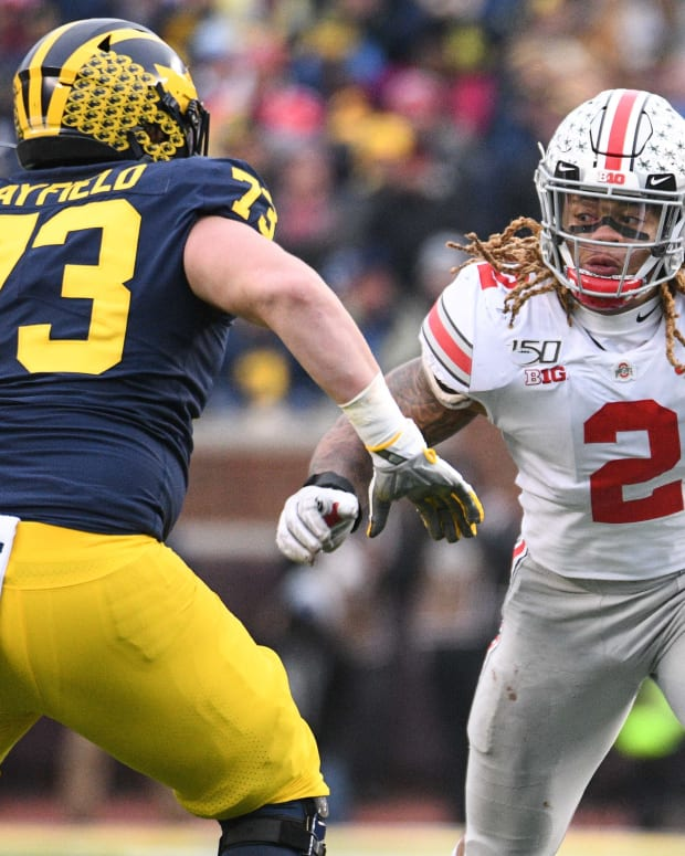 Nov 30, 2019; Ann Arbor, MI, USA; Ohio State Buckeyes defensive end Chase Young (2) battles for position with Michigan Wolverines offensive lineman Jalen Mayfield (73) during the game at Michigan Stadium. Mandatory Credit: Tim Fuller-USA TODAY Sports