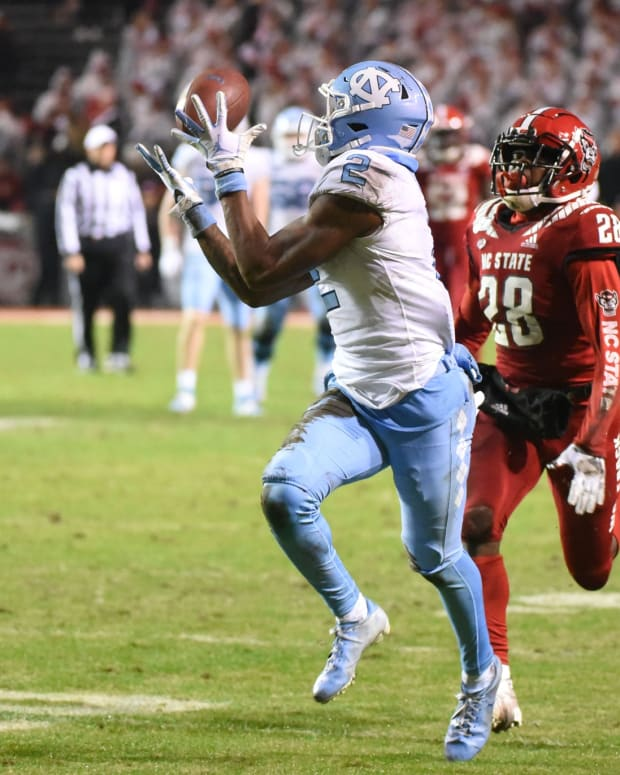 Nov 30, 2019; Raleigh, NC, USA; North Carolina Tar Heels receiver Dyami Brown (2) catches a touchdown pass against North Carolina State Wolfpack defensive back Kishawn Miller (28) during the second half at Carter-Finley Stadium. The Tar Heels won 41-10. Mandatory Credit: Rob Kinnan-USA TODAY Sports