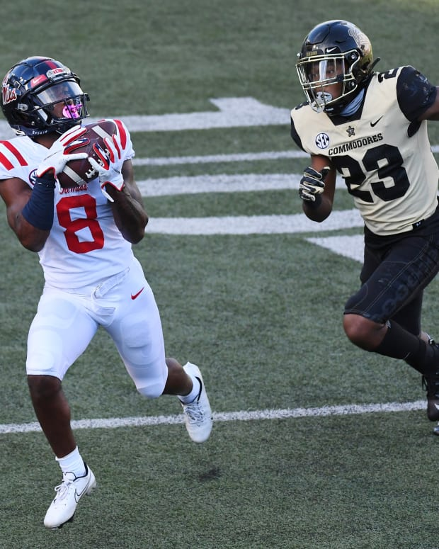 Oct 31, 2020; Nashville, Tennessee, USA; Mississippi Rebels wide receiver Elijah Moore (8) catches a touchdown pass behind coverage from Vanderbilt Commodores cornerback Jaylen Mahoney (23) during the first half at Vanderbilt Stadium. Mandatory Credit: Christopher Hanewinckel-USA TODAY Sports
