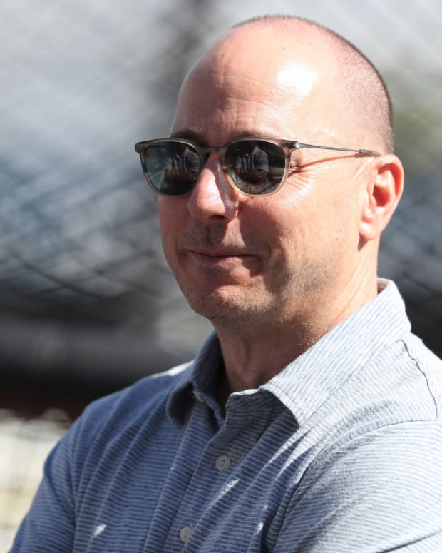 Yankees GM Brian Cashman smiling