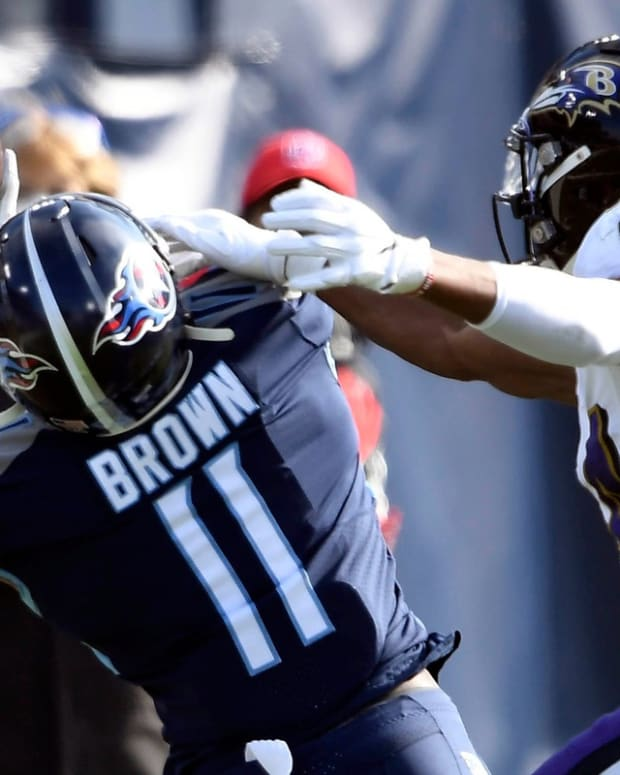 Tennessee Titans wide receiver A.J. Brown (11) pulls in a first down catch under pressure from Baltimore Ravens cornerback Marlon Humphrey (44) during the Tennessee Titans game against the Baltimore Ravens in Nashville on January 10, 2021.