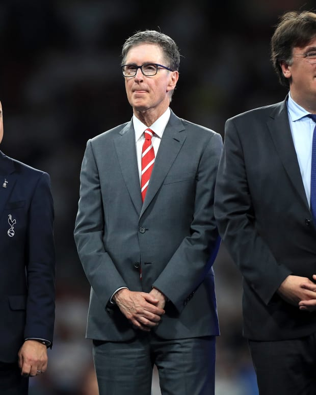 Tottenham Hotspur chairman Daniel Levy (left), Liverpool owner John W. Henry (center) and UEFA General Secretary Theodore Theodoridis.