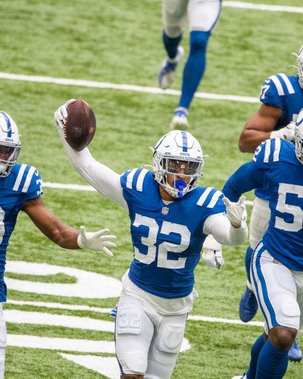 Oct 18, 2020; Indianapolis, Indiana, USA; Indianapolis Colts free safety Julian Blackmon (32) and teammates celebrate his late game interception in the second half against the Cincinnati Bengals at Lucas Oil Stadium. Mandatory Credit: Trevor Ruszkowski-USA TODAY Sports