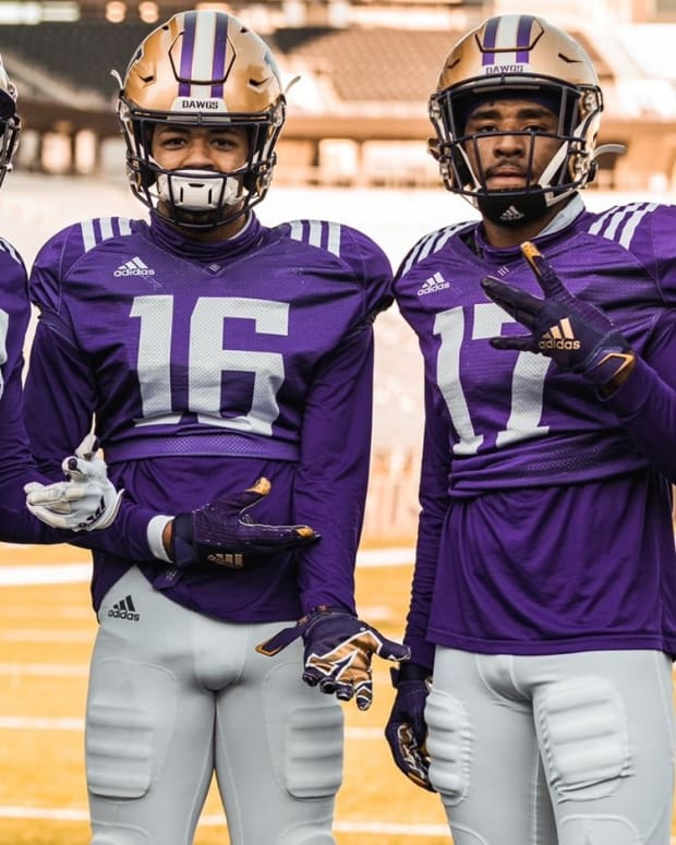 UW wide receivers Sawyer Racanelli, Ja'Lynn Polk, Rome Odunze and Taj Davis share a moment.