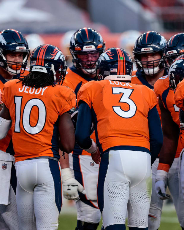Denver Broncos quarterback Drew Lock (3) huddles with teammates in the third quarter against the Los Angeles Chargers at Empower Field at Mile High.
