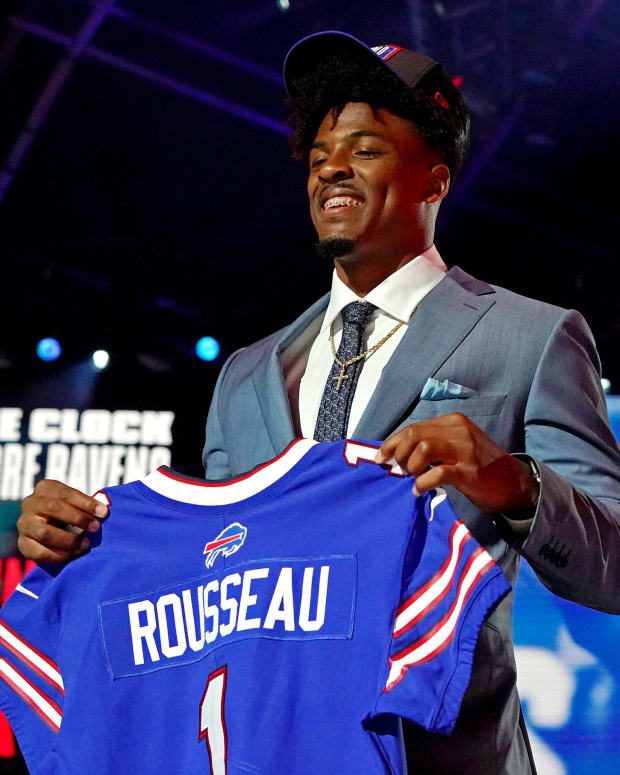 Gregory Rousseau (Miami) poses with a jersey after being selected by the Buffalo Bills as the number 30 overall pick in the first round of the 2021 NFL Draft at First Energy Stadium.