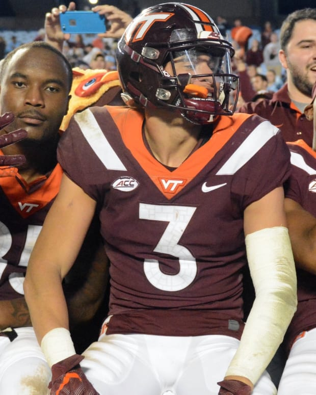 Virginia Tech Hokies defensive back Caleb Farley (3) tight end Chris Cunningham (85) and wide receiver Phil Patterson (8) celebrate with fans after a win against the North Carolina Tar Heels at Kenan Memorial Stadium. The Hokies won 22-19.
