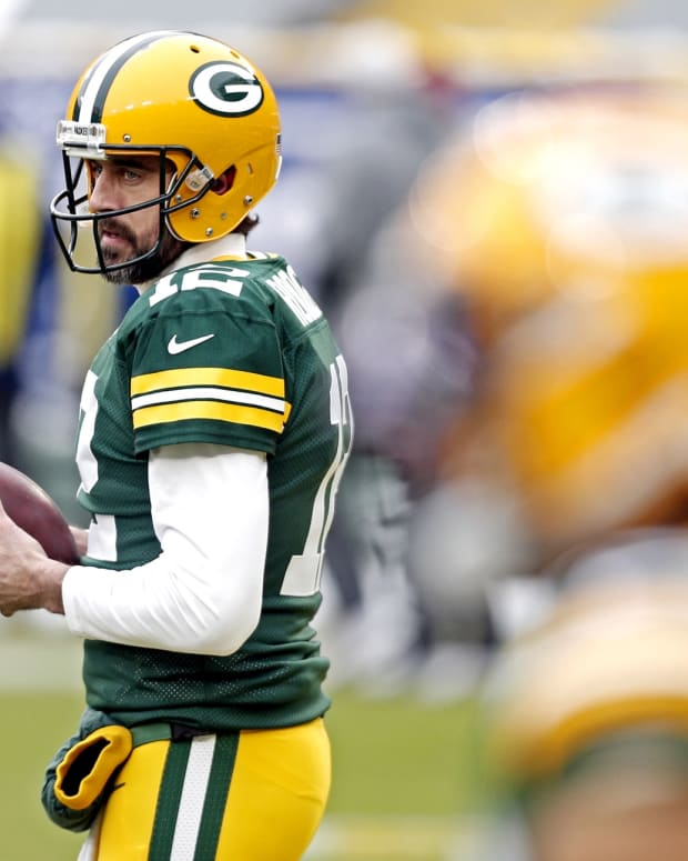Green Bay Packers quarterback Aaron Rodgers (12) warms up before playing the Tampa Bay Buccaneers at Lambeau Field.