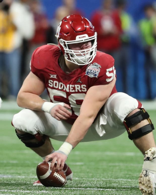 Dec 28, 2019; Atlanta, Georgia, USA; Oklahoma Sooners center Creed Humphrey (56) prepares to hike the ball during the 2019 Peach Bowl college football playoff semifinal game against the LSU Tigers at Mercedes-Benz Stadium. Mandatory Credit: Jason Getz-USA TODAY Sports