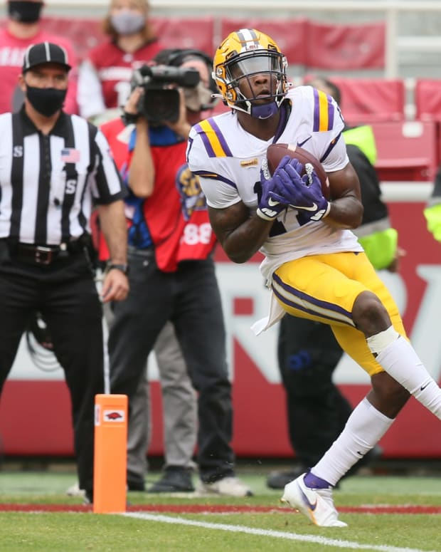 LSU Tigers wide receiver Racey McMath (17) catches a pass for a touchdown in the second quarter against the Arkansas Razorbacks at Donald W. Reynolds Razorback Stadium.