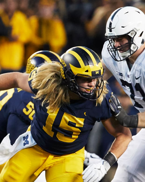 Nov 3, 2018; Ann Arbor, MI, USA; Michigan Wolverines defensive lineman Chase Winovich (15) rushes on Penn State Nittany Lions offensive lineman Will Fries (71) in the second half at Michigan Stadium. Mandatory Credit: Rick Osentoski-USA TODAY Sports