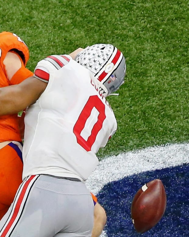 Ohio State Buckeyes defensive end Jonathon Cooper (0)) tackles Clemson Tigers quarterback Trevor Lawrence (16) during the fourth quarter at Mercedes-Benz Superdome.