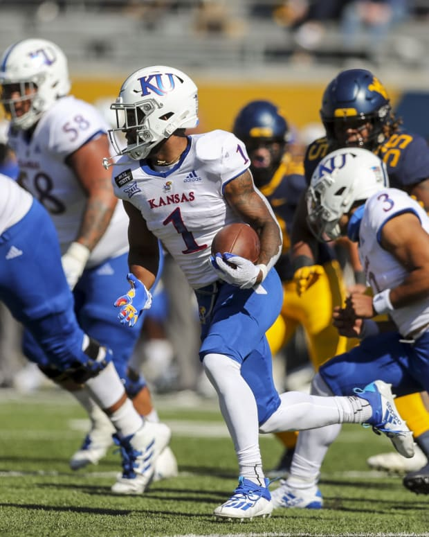 Oct 17, 2020; Morgantown, West Virginia, USA; Kansas Jayhawks running back Pooka Williams Jr. (1) runs the ball during the first quarter against the West Virginia Mountaineers at Mountaineer Field at Milan Puskar Stadium. Mandatory Credit: Ben Queen-USA TODAY Sports
