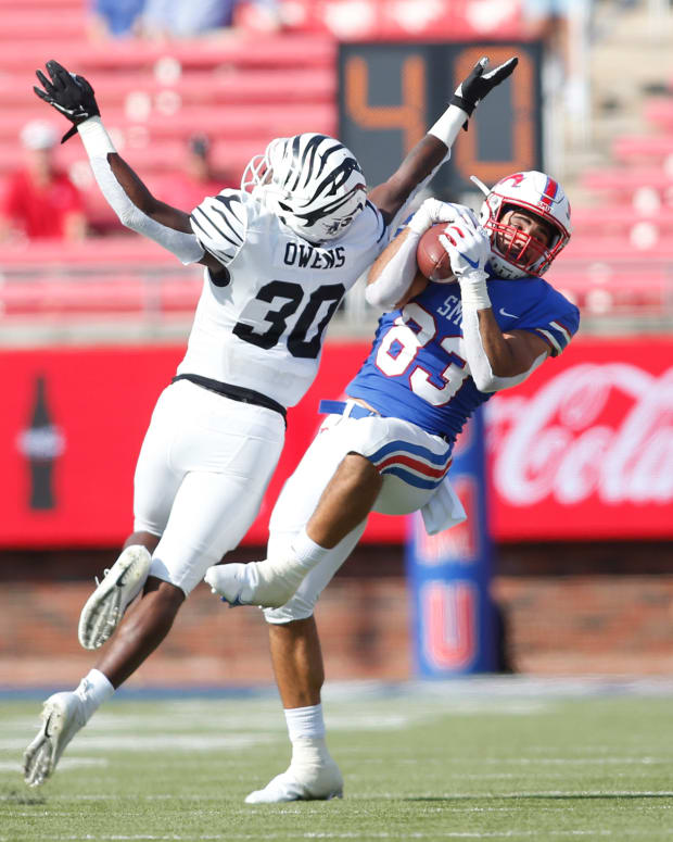 Oct 3, 2020; Dallas, Texas, USA; Southern Methodist Mustangs tight end Kylen Granson (83) catches a pass against Memphis Tigers defensive back Rodney Owens (30) in the second quarter at Gerald J. Ford Stadium. Mandatory Credit: Tim Heitman-USA TODAY Sports
