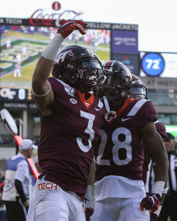 Virginia Tech Hokies defensive back Caleb Farley (3) celebrates after an interception return for a touchdown against the Georgia Tech Yellow Jackets in the second quarter at Bobby Dodd Stadium.