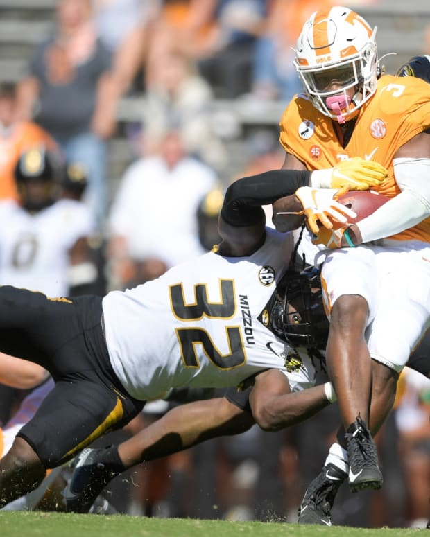 Oct 3, 2020; Knoxville, TN, USA; Tennessee running back Eric Gray (3) is tackled by Missouri linebacker Nick Bolton (32) in the fourth quarter during a game between Tennessee and Missouri at Neyland Stadium in Knoxville, Tenn. on Saturday, Oct. 3, 2020. Mandatory Credit: Calvin Mattheis-USA TODAY NETWORK
