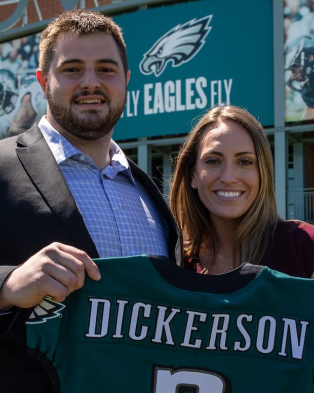 Landon Dickerson with his fiancee and Eagles jersey