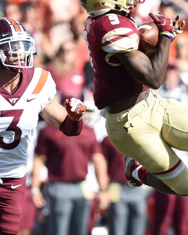Boston College Eagles wide receiver Kobay White (9) catches a pass while Virginia Tech Hokies defensive back Caleb Farley (3) defends during the first half at Alumni Stadium.