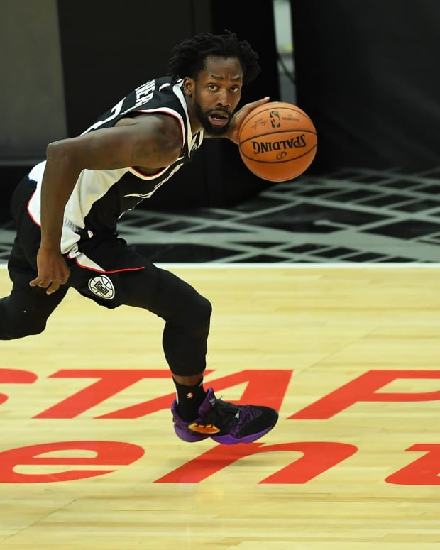 Feb 19, 2021; Los Angeles, California, USA; Los Angeles Clippers guard Patrick Beverley (21) takes the ball down court in the first half of the game against the Utah Jazz at Staples Center. Mandatory Credit: Jayne Kamin-Oncea-USA TODAY Sports