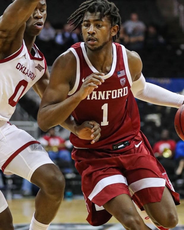 Daejon Davis drives against Oklahoma.