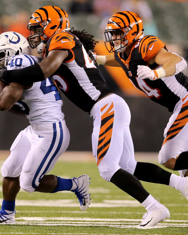 Indianapolis Colts running back Branden Oliver (40) is tackled by Cincinnati Bengals linebacker Malik Jefferson (45) and Cincinnati Bengals defensive end Sam Hubbard (94) in the fourth quarter during the Week 4 NFL preseason game between the Indianapolis Colts and the Cincinnati Bengals, Thursday, Aug. 30, 2018, at Paul Brown Stadium in Cincinnati. Indianapolis Colts Vs Cincinnati Bengals Preseason Game Aug 30