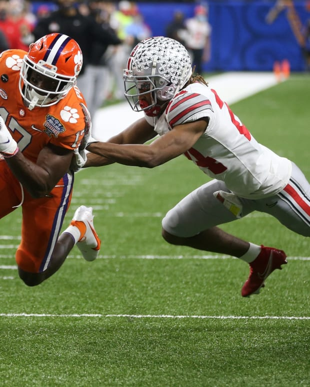 Jan 1, 2021; New Orleans, LA, USA; Clemson Tigers wide receiver Cornell Powell (17) runs the ball past Ohio State Buckeyes cornerback Shaun Wade (24) during the second half at Mercedes-Benz Superdome. Mandatory Credit: Chuck Cook-USA TODAY Sports