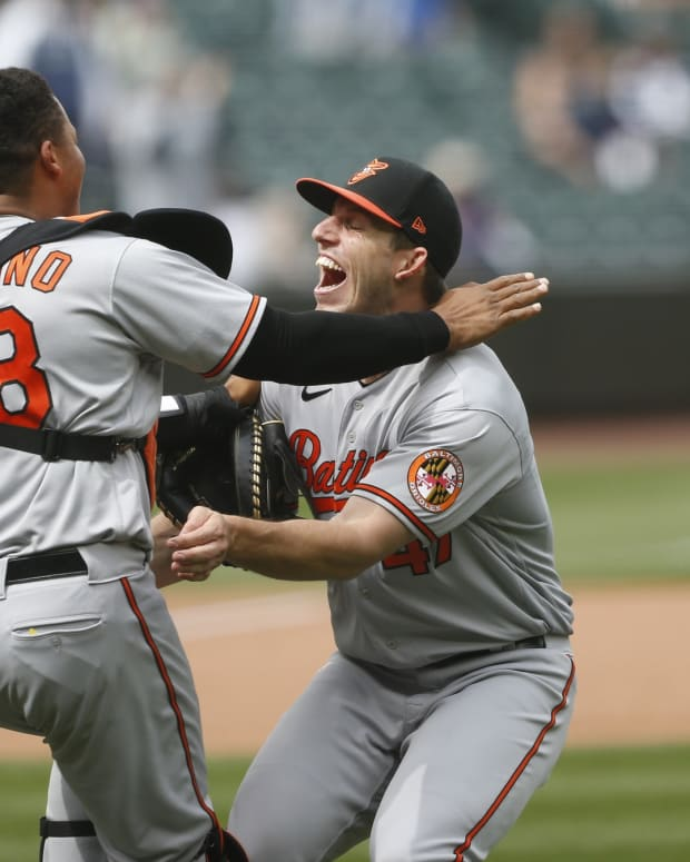 Baltimore Orioles starting pitcher John Means (47) and catcher Pedro Severino (28) celebrate following the final out of a no-hit 6-0 victory against the Seattle Mariners at T-Mobile Park.