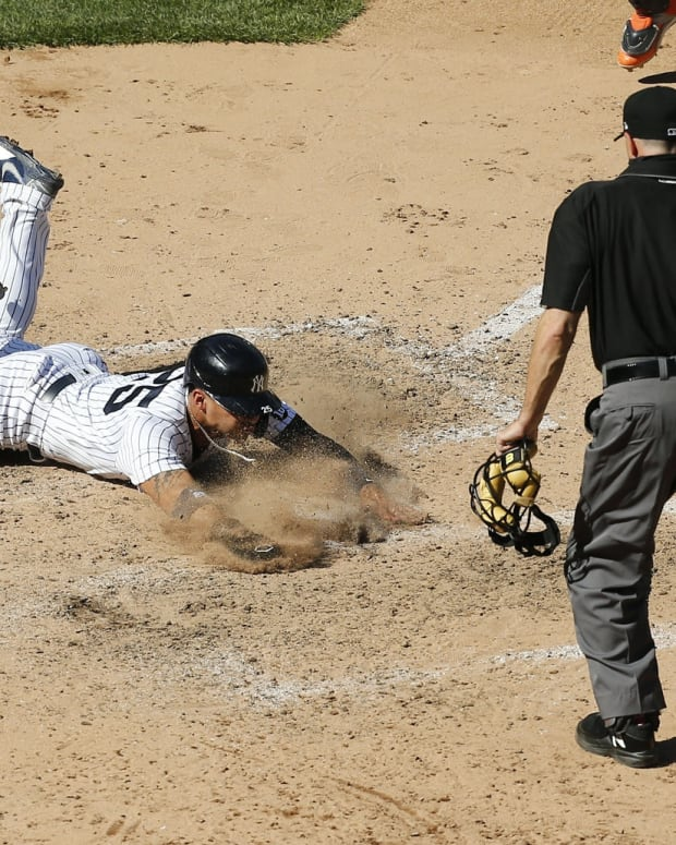 Yankees Gleyber Torres sliding into home plate