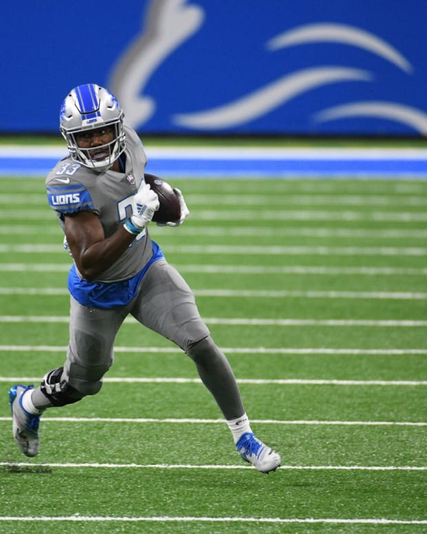 Dec 26, 2020; Detroit, Michigan, USA; Detroit Lions running back Kerryon Johnson (33) runs the ball against the Tampa Bay Buccaneers during the fourth quarter at Ford Field.
