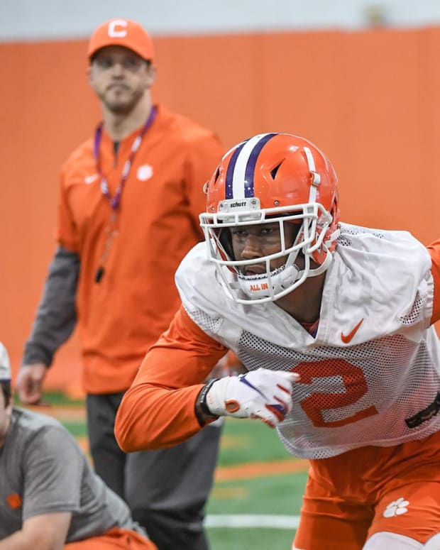 Clemson wide receiver Frank Ladson, Jr. (2) runs near wide receiver coach Tyler Grisham during practice at the Poe Indoor Facility in Clemson Friday, December 13, 2019. The Tigers are preparing for the College Football Playoffs semi-final game with Ohio State University played in Glendale, Arizona on December 28, 2019. 2019 Cfp Semi Final Game Practice In Clemson