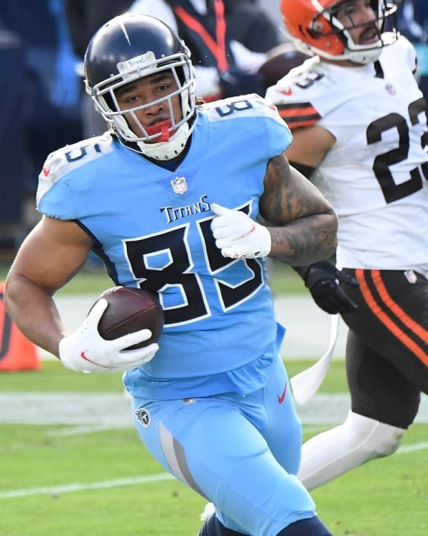 Tennessee Titans tight end MyCole Pruitt (85) runs in a touchdown after a catch past Cleveland Browns free safety Andrew Sendejo (23) during the third quarter at Nissan Stadium Sunday, Dec. 6, 2020 in Nashville, Tenn.