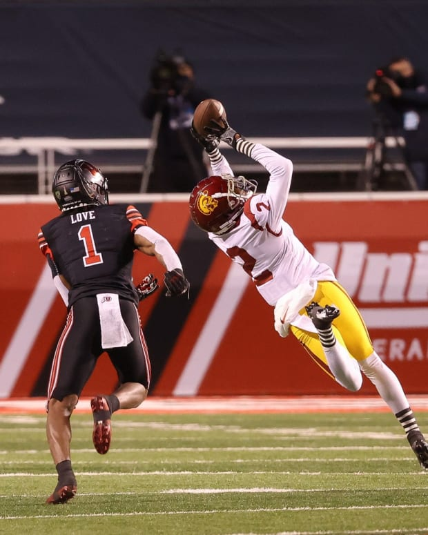 USC Trojans cornerback Olaijah Griffin (2) tries to intercept the ball during the second quarter against the Utah Utes at Rice-Eccles Stadium.