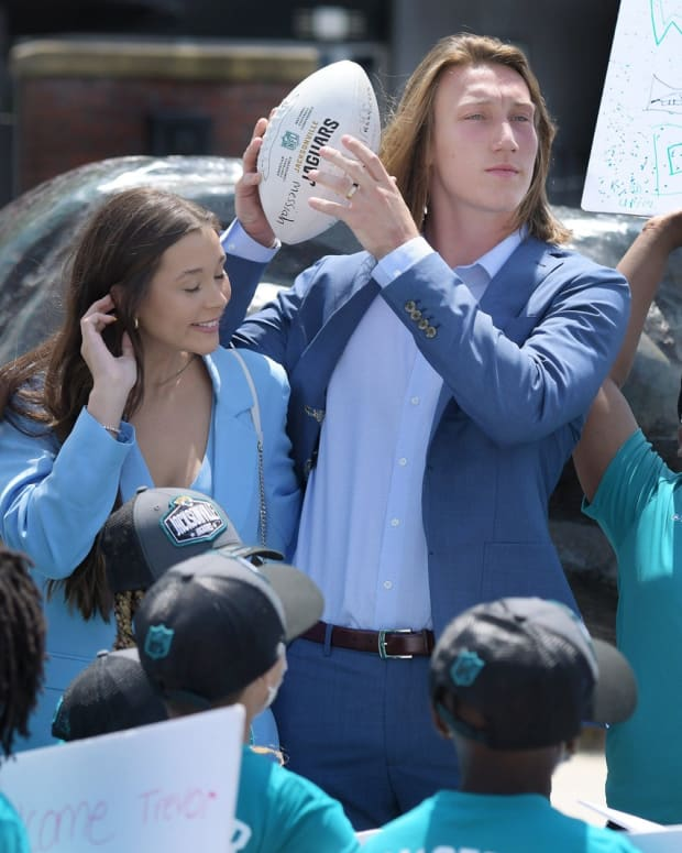 Trevor Lawrence and his wife Marissa Mowry pose with students from Long Branch Elementary School upon their arrival in Jacksonville Friday. The Jacksonville Jaguars' first-round draft pick Trevor Lawrence and his wife Marissa Mowry arrived at TIAA Bank Field in Jacksonville, Florida about noon Friday, April 30, 2021. The couple was greeted by team owner Shad Khan and 35 third-grade students from Long Branch Elementary School.