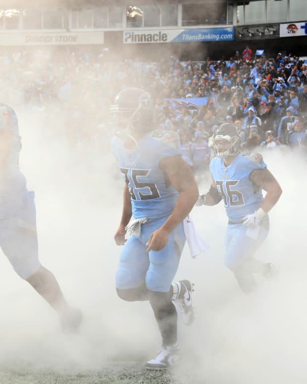 Tennessee Titans players take the field during player introductions before the game against the Houston Texans at Nissan Stadium.