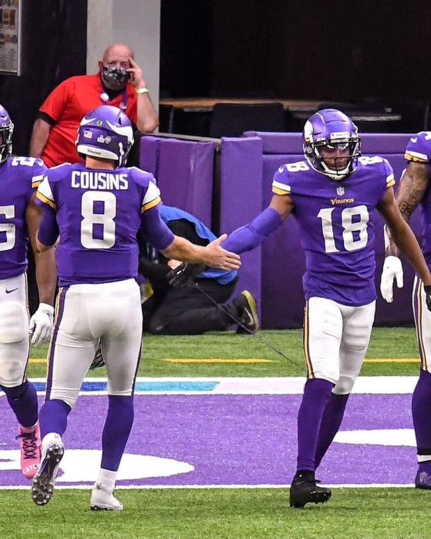 Oct 18, 2020; Minneapolis, Minnesota, USA; Minnesota Vikings quarterback Kirk Cousins (8) and Minnesota Vikings wide receiver Justin Jefferson (18) celebrate their 11-yard pass and catch for a touchdown in the third quarter at U.S. Bank Stadium. Mandatory Credit: Nick Wosika-USA TODAY Sports