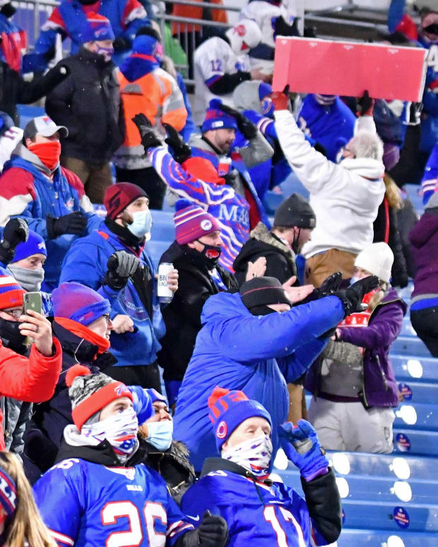 Buffalo Bills fans celebrate after cornerback Taron Johnson (not pictured) scored a touchdown after making an interception against the Baltimore Ravens during the second half of an AFC Divisional Round playoff game at Bills Stadium last January.