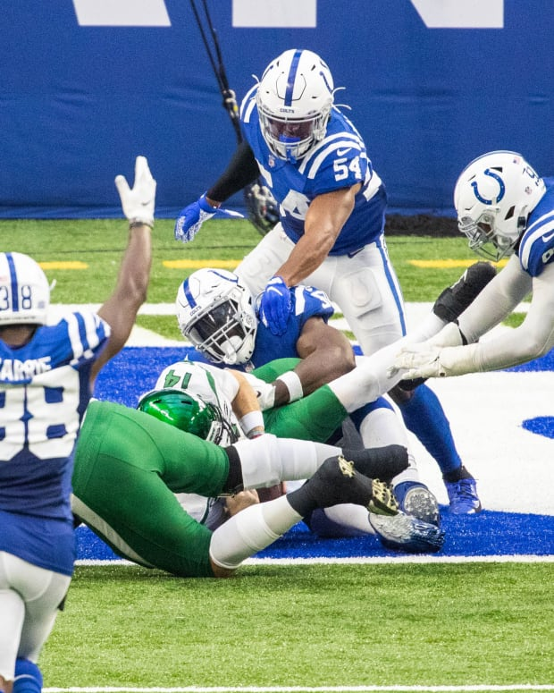 Sep 27, 2020; Indianapolis, Indiana, USA; New York Jets quarterback Sam Darnold (14) is tackled for a safety by Indianapolis Colts defensive end Justin Houston (50) in the second half at Lucas Oil Stadium.